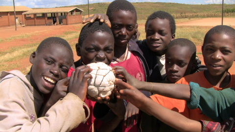 Refugees and handmade football by Heidenstrom