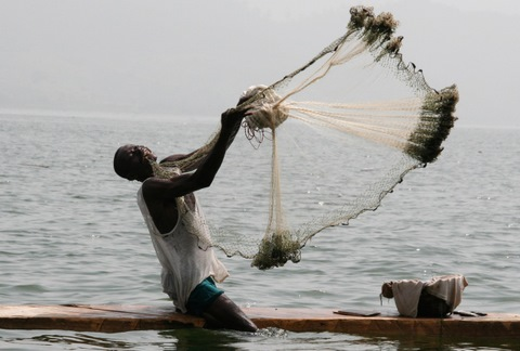 Man fishing in Ghana by Dr Tormod Eggen